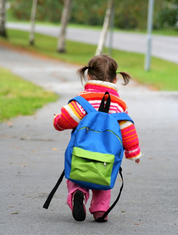 Child walking with book bag